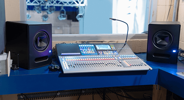 Front of house at Newton High School Auditorium, with PreSonus StudioLive 32 digital console and PreSonus Sceptre S8 studio monitors. Click for larger image.